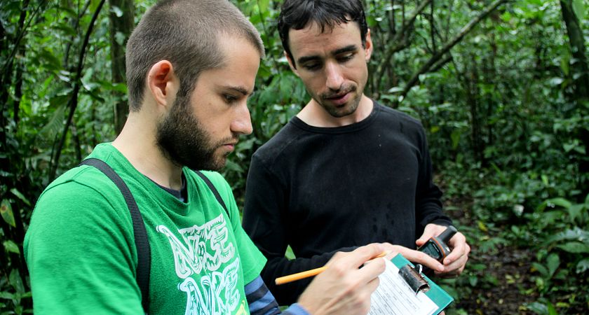 Picture of Centennial College's Global Citizenship and Equity Learning Experience (GCELE) students completing some paper work on a clipboard, in a rain forest in Costa Rica.
