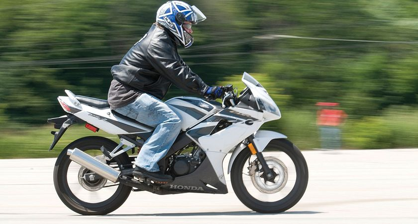 Picture of a person riding a motorcycle in the Motorcycle Rider Training course at Centennial College