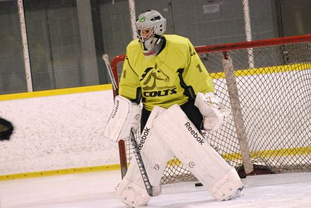 Picture of Centennial College student playing goalie in a game of hockey.