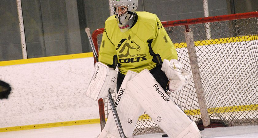 Picture of a Centennial College student playing goalie in a game of hockey.