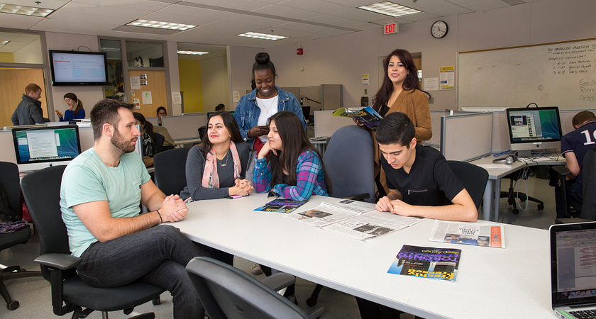 picture of Centennial College Journalism program students in a group discussion with a faculty member