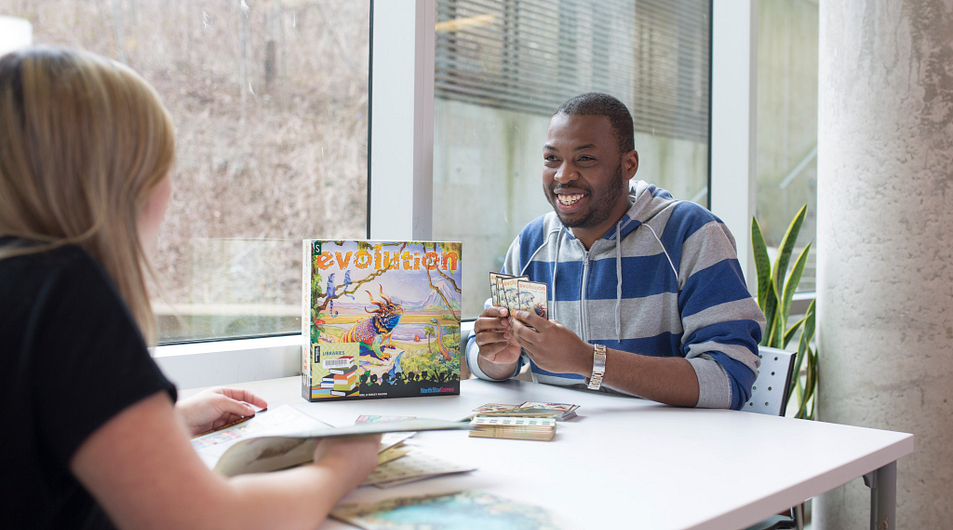 Students playing board games in the library