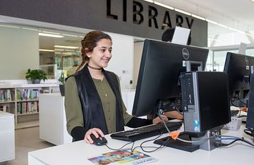 Student at a computer in the library