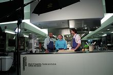 picture of the eCooking series chefs in the kitchen together talking