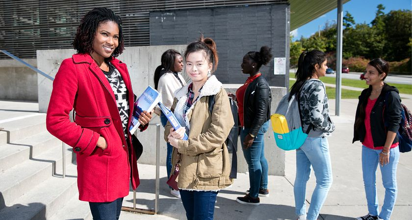 picture of centennial college students outside morningside campus on the way to a career services event
