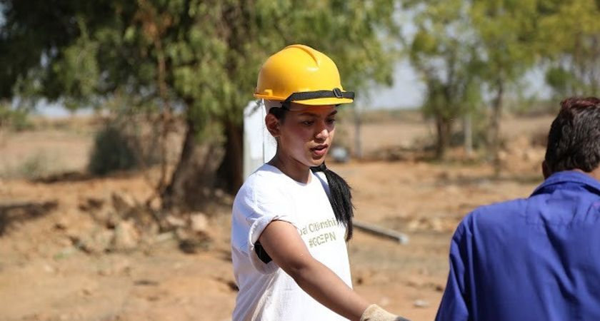 picture of a centennial college student on a GCELE in India at a construction site
