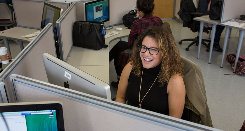 Picture of a Centennial College Journalism program student in the journalism computer lab