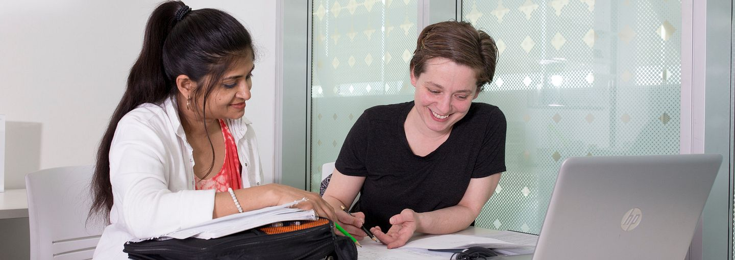 Picture of a math tutor with student at Ashtonbee campus.