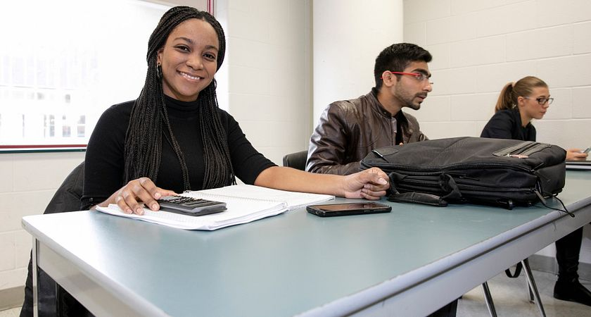 picture of a Centennial College financial services program student in class