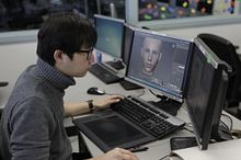 picture of a Centennial College Animation 3D program student working at a studio on workstation animating a face