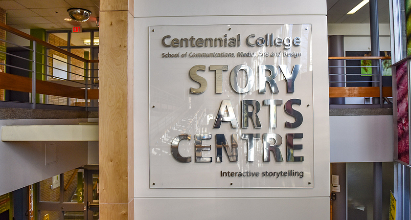 A sign on the wall displaying the words Story Arts Centre