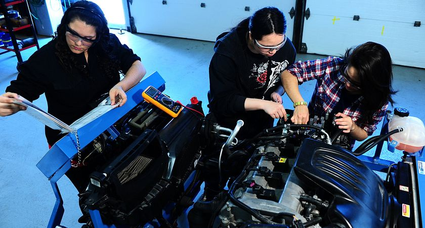 Led young College Apprenticeship Program students working on an engine.