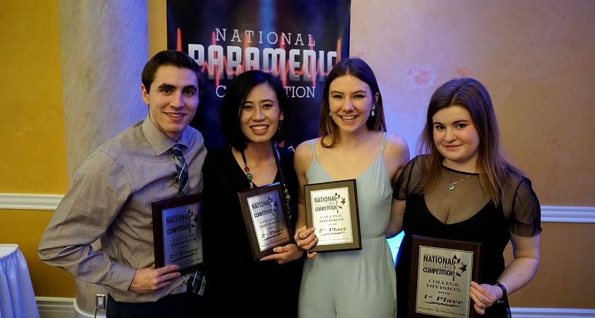 Picture of four Centennial students holding up their awards at the National Paramedic Competition