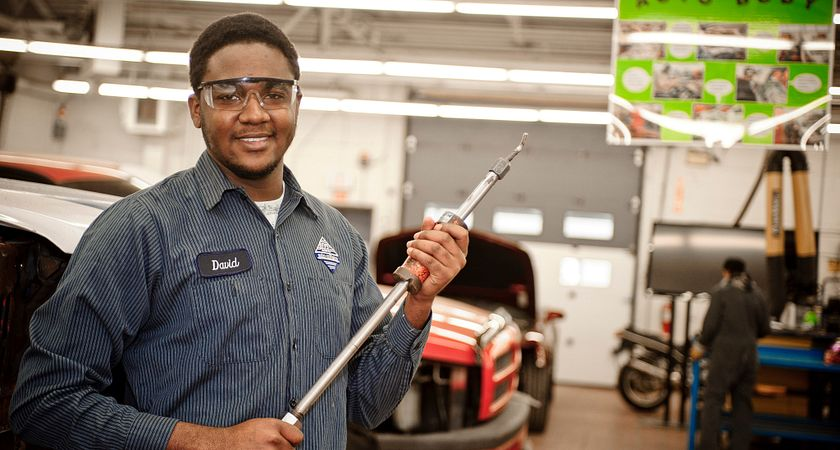 picture of a Centennial College Auto Body Repair program student in the auto body repair garage