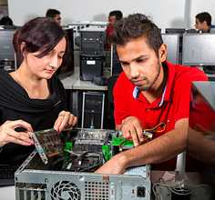 Two students repairing a computer