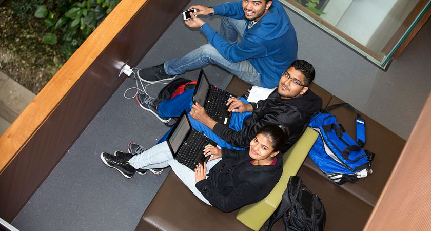 Led young College Students studying at the Progress Campus Library