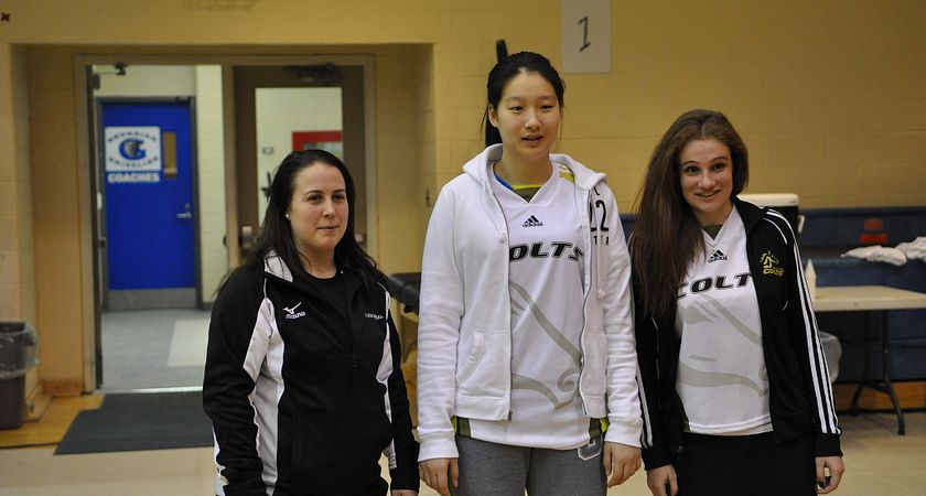 Picture of three female Centennial College badminton players looking surprised as they enter the gymnasium.