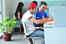 Picture of two students studying at a desk in the Progress Campus library