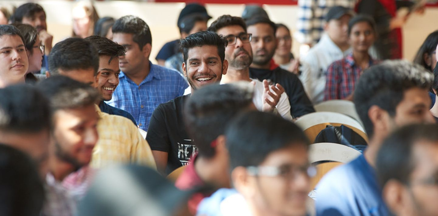 picture of Centennial College International Students smiling in a crowd at orientation