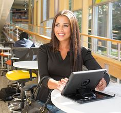 A public relations student at work at a desk at the Story Arts Centre