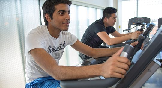 Students riding stationary bikes at the Ashtonbee Gym