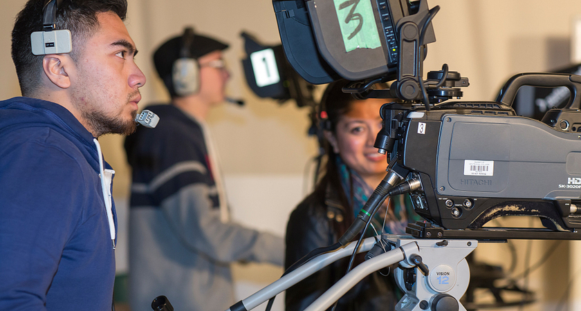 Picture of students in Broadcasting doing camera work with professional equipment, like that used in television.