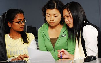 Three students working on a project