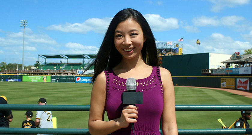 Jessica Ng reporting from a baseball game