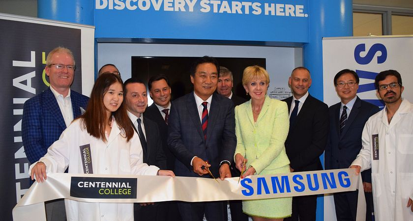 Picture of Centennial College President and CEO Ann Buller and Samsung Electronics Canada President and CEO Gi Yong Seo cutting the ribbon during Samsung Tech Institute launch ceremony.