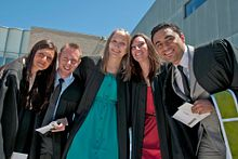 picture of a group of graduates smiling at convocation