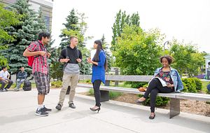 picture of Centennial College students talking to one another outside Progress Campus