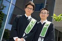 Picture of two Centennial College graduates at convocation