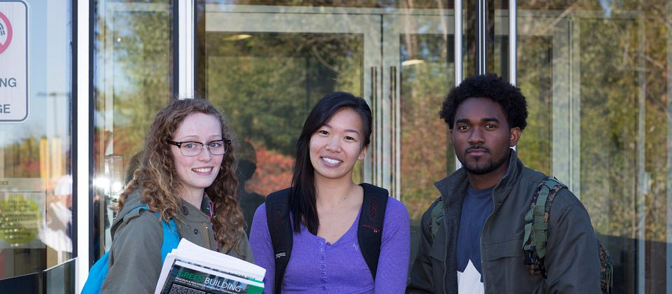 Picture of three Centennial College students standing outside of morningside campus