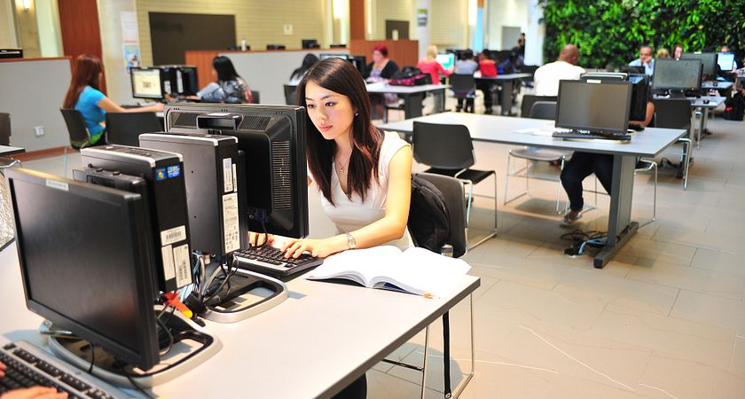 Student using the computer on the Library at Progress Campus, Centennial College