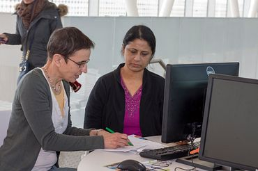 Picture of a instructor working with a IELTS preparation course student