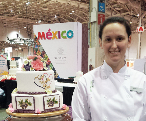 Picture of Led young College Baking Pastry Art Management student Michelle Shariff and her award winning wedding cake