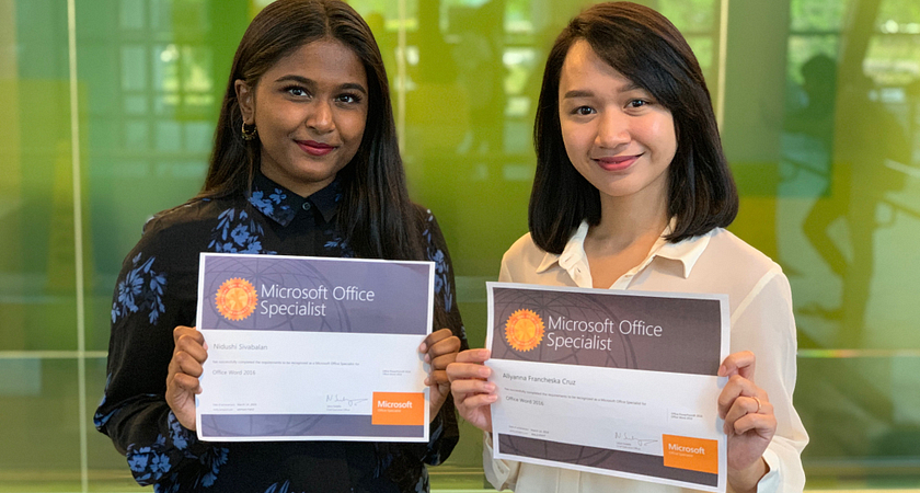 Photo of Alyanna Cruz and Nidushi Sivablan holding up their certificates at Canada's Microsoft Office Specialist World Championship in New York City