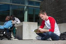 Centennial College student studying outside