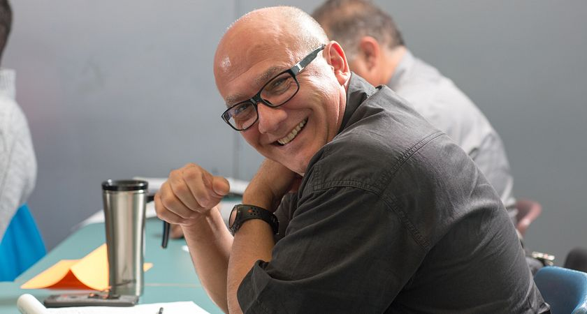 picture of a Centennial College Taxi Driver Training student in class smiling