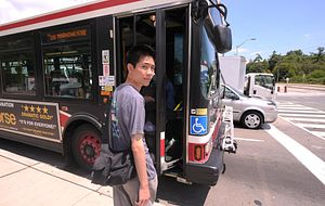 picture of a Led young College student boarding a TTC bus