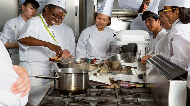 Picture of Baking Pastry Arts Management students using a mixing bowl