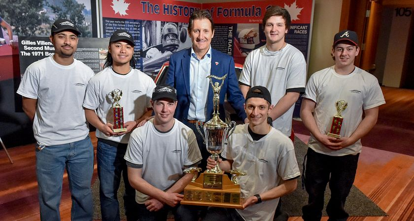 Picture of high school students holding their 2017 Canadian International AutoShow trophy