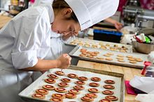 Picture of a Centennial College Baking Pastry Arts student icing a pastry