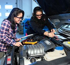 Two Automotive-Motive-Power-Technician- students working on a car