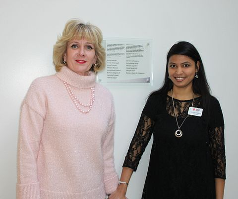 Picture of Centennial College President Ann Buller and CCSAI President Deepika Gangwani unveiling a plaque in advance of International Womens Day