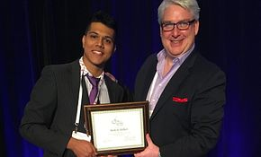 Picture of Centennial College Events Management program student Mahesh Halkeri receiving an award from an events industry association