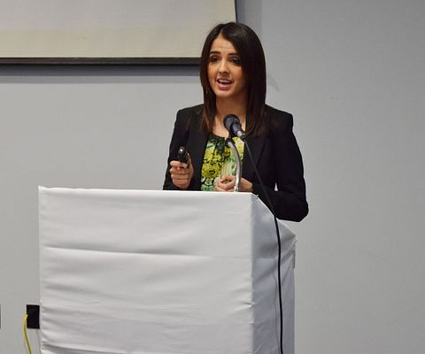 A picture of Rumeet Billan speaking to the Global Academy