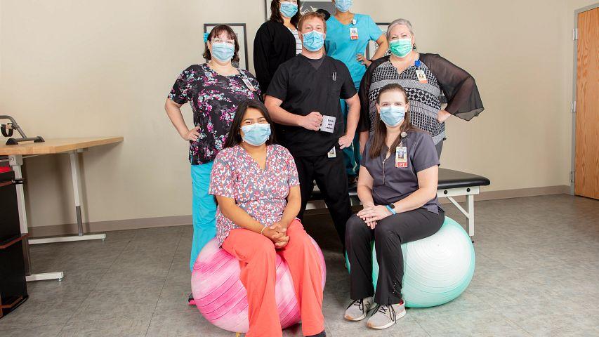 The rehabilitation team, from back left to front right, Nicole Navarro, Varada Pisharody, Lauren Banda, Tyson (Richard) Kane, Karisa White, Tiana Serrano, Lindsay Gail, at St. Catherine Hospital in Garden City, KS.