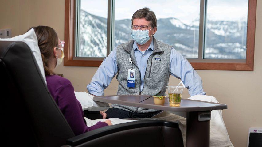 Dr. David Biggs with a patient in Summit County, Colorado, March 24, 2021.