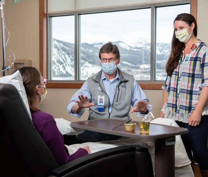 Dr. David Biggs and Krista Da Rocha, RN-Navigator, with a patient in Summit County, Colorado, March 24, 2021.